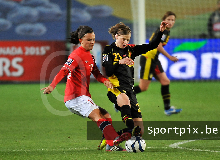 20130925 - OSLO , NORWAY : Belgian Yana Daniels (21) pictured with Norwegian Cathrine Dekkerhus (13) during the female soccer match between Norway and Belgium , on the second matchday in group 5 of the UEFA qualifying round to the FIFA Women World Cup in Canada 2015 at the Ullevaal Stadion , Oslo . Wednesday 25th September 2013. PHOTO DAVID CATRY