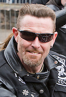 St Patricks Day parade High Street Digbeth.A portrait of a rider from the Biker Contingent  on the Parade