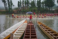 Men and women rowers take part in dragon boat practice at Jiujiang Dragon Boat base in Nanhai district of Foshan city, Guangdong province, November 8, 2011.