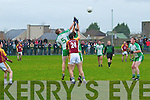 The Bernard O'Callaghan Memorial Senior Football Championship 2013, Round 1 Ballyduff (white/green) V Duagh (Red) which took place on Sunday in Frank Sheehy Park, Listowel.  Referee: Billy McElligot, Listowel Emmets.<br /> <br /> Evan Doyle and Garry O'Brien of Ballyduff and Anthony Maher of Duagh challenging each other for the ball in the duagh half.