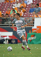 FC Dallas midfielder Aaron Pitchkolan (17) dribbles the ball.  Houston Dynamo defeated FC Dallas 1-0 in an MLS regular season match at Robertson Stadium in Houston, TX on August 19, 2007.