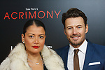 "Alex Lundqvist (right) and Keytt Lundqvist arrive on the red-carpet for the Tyler Perry""s ACRIMONY movie premiere at the School of Visual Arts Theatre in New York City, on March 27, 2018."