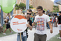 A young attendant of the Holland Pavilion at Expo 2015 hold a sign that reads &quot;Smile! And take a selfie!&quot; , Rho-Pero, Milan, 2015. And you can not photograph him without someone comes by side. &copy; Carlo Cerchioli <br /> <br /> &quot;Sorridi! e fatti un selfie!&quot; recita il cartello impugnato dal giovane addetto del padiglione Olanda a Expo 2015, Rho-Pero, Milano, 2015. E non si riesce a fotografarlo senza che qualcuno gli si metta a fianco.