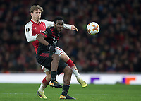 Nacho Monreal of Arsenal battles with Franck Kessie of AC Milan during the UEFA Europa League round of 16 2nd leg match between Arsenal and AC Milan at the Emirates Stadium, London, England on 15 March 2018. Photo by Vince  Mignott / PRiME Media Images.