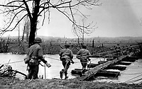 BNPS.co.uk (01202 558833)<br /> USAMHI/BNPS<br /> <br /> US Ninth Army soldiers cross to assault boats that engineers had laid across the Roer River for Operation Grenade. <br /> <br /> Remarkable rarely seen photos of heroic Allied soldiers fighting their way across Europe before crossing the River Rhine 75 years ago feature in a new book.<br /> <br /> They are published in Images of War, Montgomery's Rhine Crossing, which tells the story of the legendary offensive, nicknamed Operation Plunder, in March 1945.<br /> <br /> On the night of March 23, Field Marshal Bernard Montgomery's 21st Army Group launched a massive artillery, amphibious and airborne assault to breach the historic defensive water barrier protecting northern Germany.<br /> <br /> At the same time, the Americans, with the support of the British 6th Airborne Division, set in motion Operation Varsity - involving 16,000 paratroopers - on the east bank of the Rhine. They were dropped here to seize bridges to prevent German reinforcements from contesting the bridgeheads.<br /> <br /> Fierce fighting ensued, with much bloodshed on both sides as the Allies met determined resistance from machine gun nests. But the daring operation proved successful, helping to considerably shorten the war - the Nazis surrendered just six weeks later.