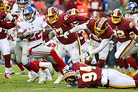 Landover, MD - December 9, 2018: New York Giants running back Wayne Gallman (22) gets tackled by Washington Redskins outside linebacker Preston Smith (94) during the  game between New York Giants and Washington Redskins at FedEx Field in Landover, MD.   (Photo by Elliott Brown/Media Images International)