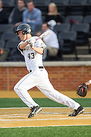 Grant Shambley (43) of the Wake Forest Demon Deacons follows through on his swing against the Maryland Terrapins at Wake Forest Baseball Park on April 4, 2014 in Winston-Salem, North Carolina.  The Demon Deacons defeated the Terrapins 6-4.  (Brian Westerholt/Four Seam Images)