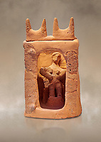 Minoan clay model shrine depicting a priestess playing the part of a goddess in a small single roomed house, Galatas 1700-1650 BC; Heraklion Archaeological  Museum.