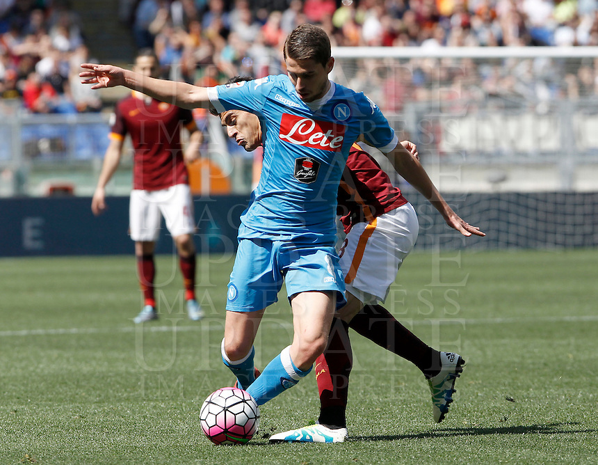 Calcio, Serie A: Roma vs Napoli. Roma, stadio Olimpico, 25 aprile 2016.<br /> Napoli's Jorginho, left, is challenged by Roma's Diego Perotti during the Italian Serie A football match between Roma and Napoli at Rome's Olympic stadium, 25 April 2016. <br /> UPDATE IMAGES PRESS/Isabella Bonotto