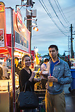 CANADA, Vancouver, British Columbia, portrait of a young couple at Magical Duck Island, Richmond Asian Night Market