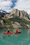 Trent and Linda Enzsol paddle a Wenonah Escape on Maligne Lake, Jasper National Park, Alberta, Canada. Water is colored by glacial silt