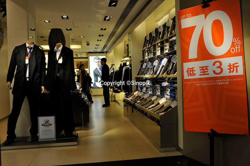 A clothes store offers 30% off in a sale in Causeway Bay, Hong Kong. Hong Kong's slumping economy will shrink further in the first half of 2009..