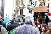 "Hundreds of protesters march with the aim to shut down Wall Street and the Stock Exchange on November 17, 2011 in New York City.  The action was part of a day of protests celebrating the two month anniversary of the ""Occupy Wall Street"" movement.  While many workers were inconvenienced by the human (and police) barricades, the Stock Exchange opened on schedule."