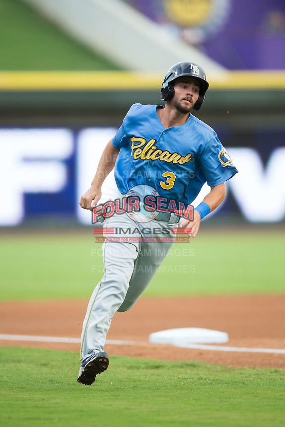 Chesney Young (3) of the Myrtle Beach Pelicans rounds third base on his way to scoring a run in the top of the first inning against the Winston-Salem Dash at BB&T Ballpark on August 20, 2015 in Winston-Salem, North Carolina.  The Dash defeated the Pelicans 5-4 on a walk-off wild pitch in the bottom of the 9th inning.  (Brian Westerholt/Four Seam Images)