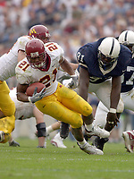 27 September 2003:  Marion Barber III (21) spins away from a tackle by Penn State's Tamba Hali (91).  Barber finished the game with 138 yards.  Minnesota defeated Penn State 20-14  at Beaver Stadium in State College, PA.<br /> Mandatory Credit: Randy Litzinger
