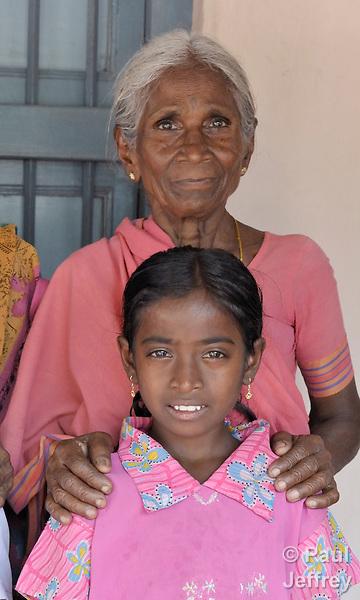 Lakshmi Kanthamma and her 8-year old granddaughter, Anandan, an HIV-positive orphan in Guntur, Andhra Pradesh, India. (See Special Instructions below.)