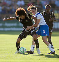 Eriko Arakawa (30) keeps the ball away from Kelly Shmedes (3) as Formiga (31) looks on. Boston Breakers defeated FC Gold Pride 1-0 at Buck Shaw Stadium in Santa Clara, California on July 19, 2009.