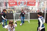 Former women's national team players Michelle Akers and April Heinrichs play a small sided game during the centennial celebration of U. S. Soccer at Times Square in New York, NY, on April 04, 2013.