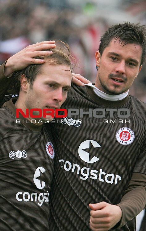 2.Liga FBL 2008/2009  11. Spieltag Hinrunde<br /> FC St.Pauli &ndash; vs. 1.FC N&uuml;rnberg 1:0<br /> <br /> Filip Trojan links (Nr.6) und Alexander Ludwig (Nr.18) rechts bejubeln das 1:0.<br /> <br /> <br /> <br /> Foto &copy; nph (nordphoto)<br /> <br /> *** Local Caption ***