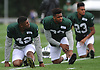 Ronald Martin #42, left, stretches with Jamal Adams #33, center, and Dexter McDougle #23 during New York Jets Training Camp at the Atlantic Health Jets Training Center in Florham Park, NJ on Tuesday, Aug. 8, 2017.