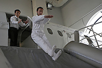 China South West Airlines' pilot tries an emergency drill with aircraft performance instructor in the training centre of Airbus China Ltd., Beijing, China..19 Jan 2005
