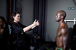 JOHANNESBURG, SOUTH AFRICA - MARCH 27: A male model is prepared by an assistnat backstage before a fashion show at the South African fashion week on March 27, 2010, Turbine Hall in central Johannesburg, South Africa. Buyers and celebrities watched the 3 day fashion week, a biannual event. (Photo by Per-Anders Pettersson/Getty Images)