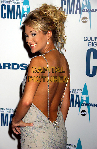 CARRIE UNDERWOOD.40th Annual CMA Awards held at Gaylord Entertainment Center, Nashville, Tennessee, USA..November 6th, 2006.Ref: ADM/LF.half length white dress looking over shoulder backless.www.capitalpictures.com.sales@capitalpictures.com.©Laura Farr/AdMedia/Capital Pictures.