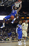 Vanderbilt guard/forward Jeffery Taylor (44), of Sweden,  and Kentucky guard Eric Bledsoe (24) watch as Kentucky guard John Wall (11) dunks the ball in the first half of an NCAA college basketball game in Nashville, Tenn., Saturday, Feb. 20, 2010.  (AP Photo/Frederick Breedon)