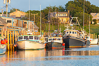 Commercial fishing boats docked in Menemsha Basin, in the fishing village of Menemsha in Chilmark, Massachusetts on Martha's Vineyard.