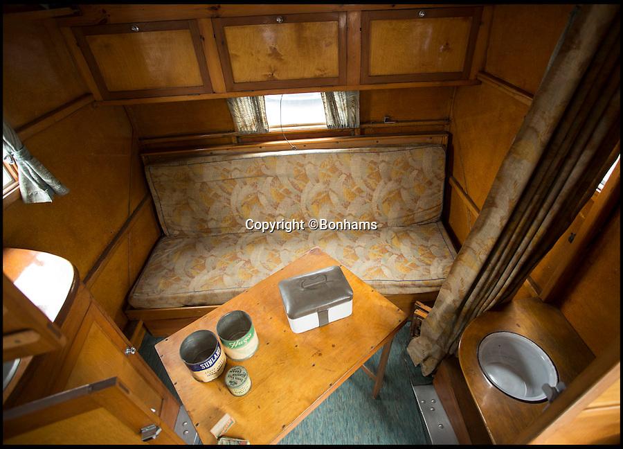 BNPS.co.uk (01202 558833)<br /> Pic: Bonhams/BNPS<br /> <br /> Untouched interior.<br /> <br /> Britain's first motorhome revealed - As eccentric British pioneers 80 year old home on wheels trundles up for auction.<br /> <br /> The pre-war creation of Capt Dunn, an aristocrat from Bexhill-on-Sea, is believed to be the earliest motorhome in the UK.<br /> <br /> Enterprising Dunn shipped a Pontiac Six chassis over from America in 1935, engaged local coach builders to craft a bespoke<br /> <br /> home from home on to the back, and then set off into the British countryside in his new creation.<br /> <br /> The unique vehicle has been untouched since Dunn died in the 1940's and auctioneers Bonhams are now selling the time capsule<br /> <br /> camper at the Goodwood Revival on 10th September with a £40,000 estimate.