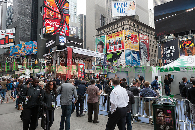 Visitors walk among the attractions at the Road to London 100 Days Out Celebration in Times Square in New York City, New York, USA on Wednesday, April 18, 2012.  Times Square was transformed into an Olympic Village for the event.