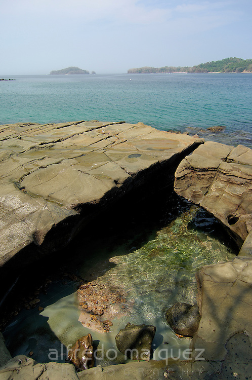 Flat rocks in Contadora island shore. Las Perlas archipelago, Panama province, Panama, Central America.