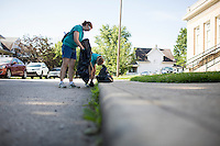 "Molly Baumann, left, and Sally Finkel pick up trash near the Hawthorne Community Center during ""Circle the City with Service,"" the Kiwanis Circle K International's 2015 Large Scale Service Project, on Wednesday, June 24, 2015, in Indianapolis. (Photo by James Brosher)"