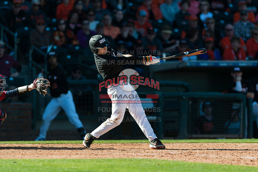 Oregon State Beavers second baseman Andy Armstrong (9) lines a single to left field during a game against the Gonzaga Bulldogs on February 16, 2019 at Surprise Stadium in Surprise, Arizona. Oregon State defeated Gonzaga 9-3. (Zachary Lucy/Four Seam Images)