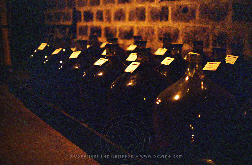 Disznoko winery: demijohns of the rare Tokaj Eszencia in the cellar. The Disznók? winery is owned by AXA Millesimes, a French insurance company. Disznoko means pig's head since a big rock in the vineyard supposedly looks like that. The new winery is impressive and a vast amount of money has been invested. Credit Per Karlsson BKWine.com