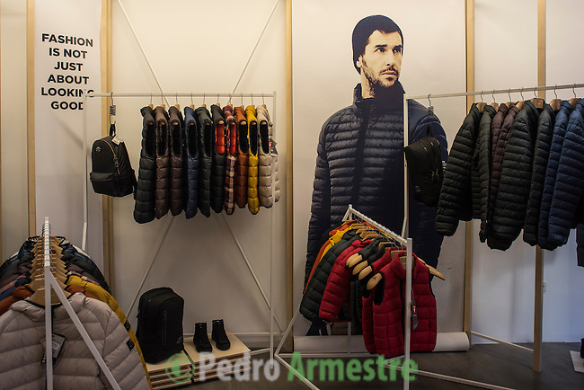 "A picture taken on November 11, 2015 shows clothes made from recycled waste in a shop of Madrid. Ecoalf, a Spanish Madrid-based firm founded in 2010, has already launched ""a new generation"" of clothes and accessories made from plastic bottles, old fishing nets and used tires found on land.  © Pedro ARMESTRE"