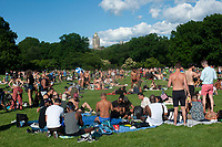 NEW YORK, NY - June 14: People socialize in Central Park without masks and without keeping six feet of distance on June 14, 2019 in New York City. Despite the public health protocols recommended by health authorities and elected officials, some people continue to meet with little regard for the risk of propagating the coronavirus. (Photo by Stephen Ferry/VIEWpress)