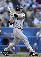 Larry Walker of the Colorado Rockies bats during a 2002 MLB season game against the Los Angeles Dodgers at Dodger Stadium, in Los Angeles, California. (Larry Goren/Four Seam Images)
