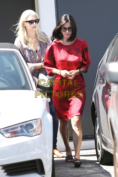 BEVERLY HILLS, CA - JUNE 2: Courteney Cox seen leaving a hair salon in Beverly Hills, California on June 2, 2015. Credit: John Misa/MediaPunch