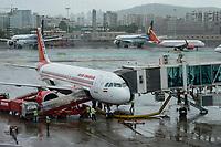 INDIA, Mumbai , Chatrapati Shivaji International Airport, Airbus of Air India and behind aircraft of Jet Airways