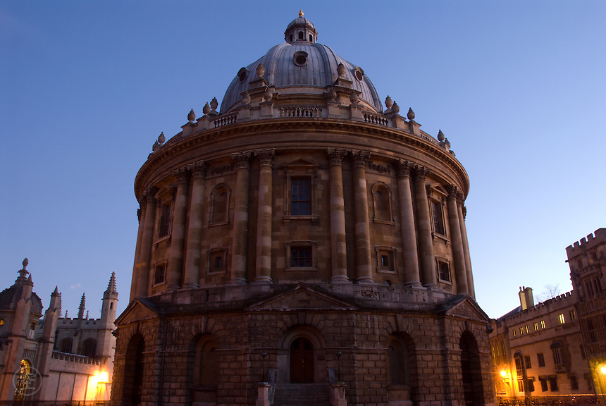 Oxford's Radcliffe Camera, the University's most famous building, at dusk with a blue sky behind the iconic library.