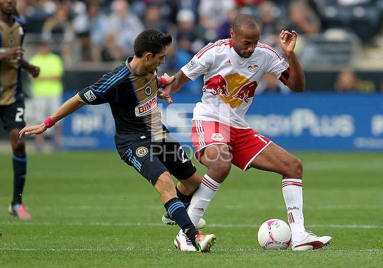 CHESTER, PA - OCTOBER 27, 2012:  Michael Farfan (21) of the Philadelphia Union moves in on  Thierry Henry (14) of the New York Red Bulls during an MLS match at PPL Park in Chester, PA. on October 27. Red Bulls won 3-0.