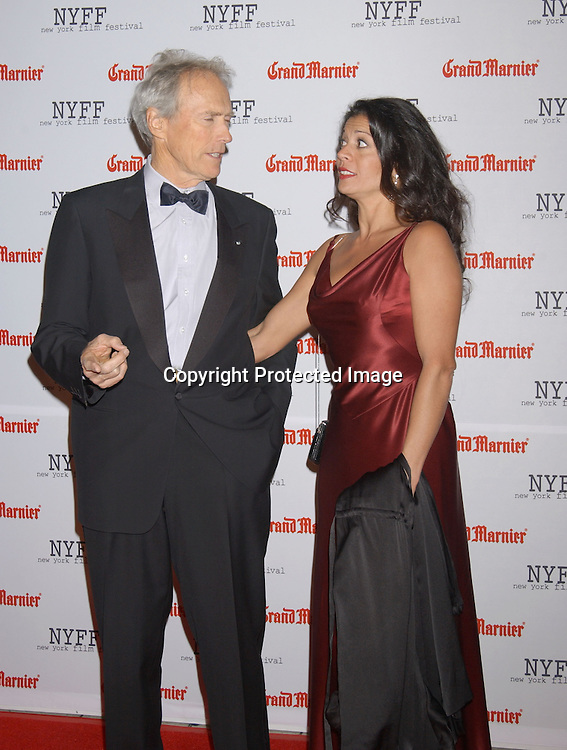 """..Clint Eastwood and wife Dina..arriving at the opening of the 41st New York Film Festival ..screening of """" Mystic River"""" on October 3, 2003 in New York City. Photo By Robin Platzer, Twin Images"""
