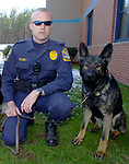 FILE....State Trooper Kevin Eklund and his dog Magnum, outside of Troop C in Tolland Wednesday. A Jim Michaud pic 4/5/06