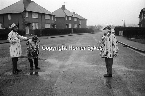 Ripon Sword Dance Play, Boxing Day, Ripon, Yorkshire 1971. Eddie Hardcastle ( on right) with family members.<br /> <br /> My ref processed in January 1972, taken Boxing Day 1971