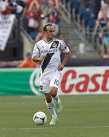 LA Galaxy forward Landon Donovan (10) brings the ball forward and looks to pass. In a Major League Soccer (MLS) match, the New England Revolution (blue) defeated LA Galaxy (white), 5-0, at Gillette Stadium on June 2, 2013.