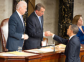 United States President Barack Obama, right, shakes hands with the Speaker of the U.S. House John Boehner (Republican of Ohio), center, after the President delivered his State of the Union Address to a Joint Session of Congress in the U.S. Capitol in Washington, D.C., Tuesday, January 24, 2012.  Looking on is U.S. Vice President Joseph Biden..Credit: Ron Sachs / CNP.(RESTRICTION: NO New York or New Jersey Newspapers or newspapers within a 75 mile radius of New York City)