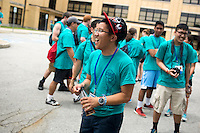 "Tuan Pham reacts to a group chant at lunch during ""Circle the City with Service,"" the Kiwanis Circle K International's 2015 Large Scale Service Project, on Wednesday, June 24, 2015, in Indianapolis. (Photo by James Brosher)"
