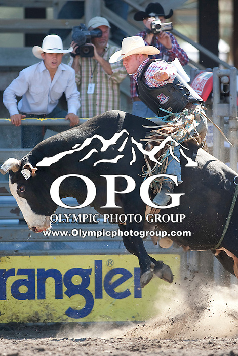 28 Aug 2011: Ty Clearwater riding the bull Mr. Smooth was not able to score during the first round of the Seminole Hard Rock Extreme Bulls competition at the Kitsap County Stampede in Bremerton, Washington.