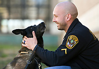 NWA Democrat-Gazette/CHARLIE KAIJO Rogers MPO Travis Pennington (right) pets his K-9, Arem, a five-year-old Belgian Malinois, Monday, March 5, 2018 at Elmwood Middle School in Rogers.<br /><br />The Rogers Police department took K-9s to Elmwood's REACH class (Reaching Exceptional, Academic and Creative Heights). The students are participating in a forensics unit where they receive hands on career experience.